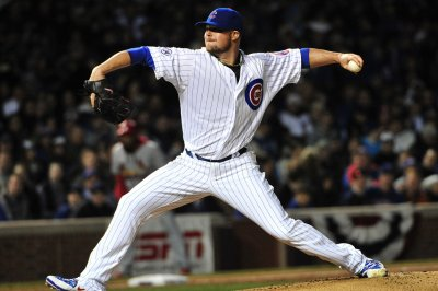 Jon Lester pitches Chicago Cubs to a split with Pittsburgh Pirates