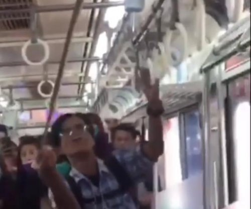 Brave passenger makes quick work of snake on commuter train