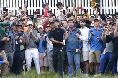 Trump calls into golf match, wants big crowds with no masks at sporting events