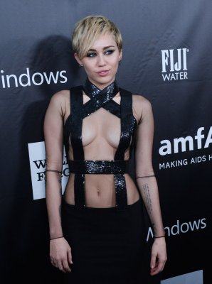 Miley Cyrus dons revealing, bondage-inspired dress at amfAR Gala