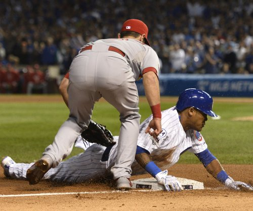 Chicago Cubs' Addison Russell leaves with hamstring ailment