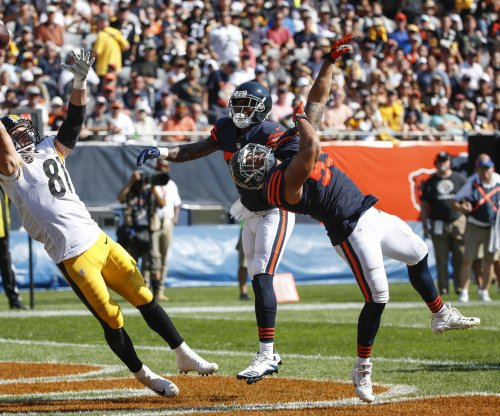 Chicago Bears re-sign LB John Timu