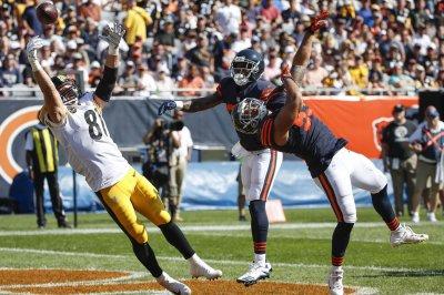 Chicago Bears re-sign LB John Timu