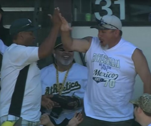 Oakland A's fan catches two foul balls on two straight pitches