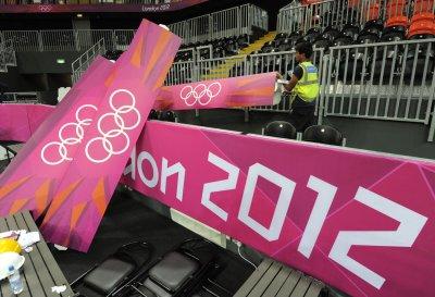 Romney softens Olympics remarks