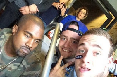 Kanye West frowns in fans' Super Bowl selfies