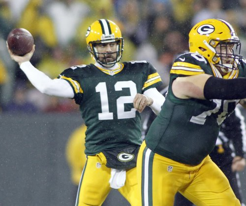 Green Bay Packers' Aaron Rodgers, other holdouts likely to see action Thursday night