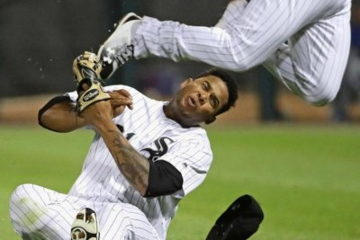 Chicago White Sox rookie Yoan Moncada exits on stretcher after collision