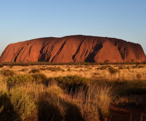 Climbing barred on Australia's famed Uluru rock to 'right historic wrong'