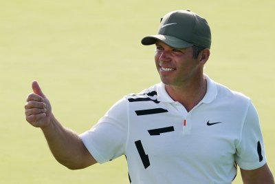 Paul Casey leads Masters in rain-shortened first day; Tiger starts strong