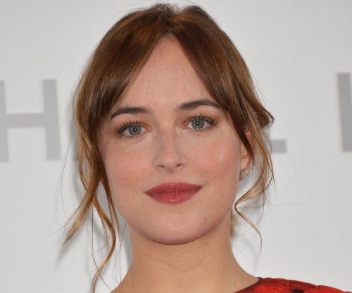 Dakota Johnson says her top nearly fell off at PCAs