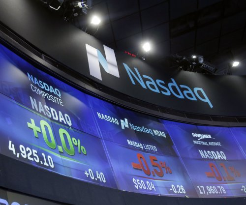 Nasdaq closes at highest level in history, tops record set 15 years ago