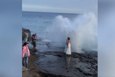 Watch:-Huge-wave-crashes-down-on-couple-posing-for-wedding-photos