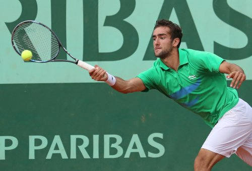Cilic returns from ban, wins Paris Masters first-rounder