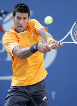 Djokovic rallies for quarterfinal win