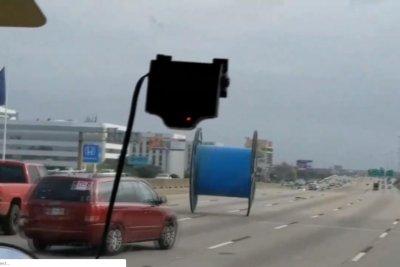 Giant spool rolls through traffic on Houston highway