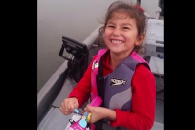 Girl reels in 20-inch bass with Barbie fishing pole