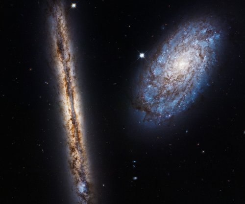 Hubble celebrates 27th birthday with tilted view of two spiral galaxies