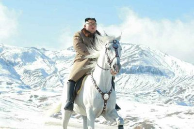 Kim Jong Un shown 'horsing' around on snow-covered Mount Paektu