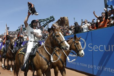 San Francisco Giants raise another banner, then fall to Colorado Rockies