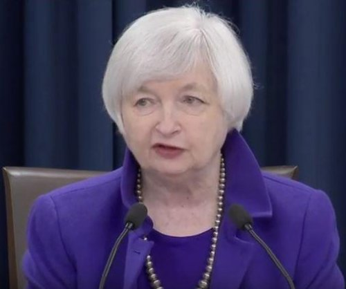 Federal Reserve raises key interest rate for first time in 9 years; Gradual hikes expected in '16