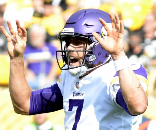 Minnesota Vikings beat Detroit Lions on Thanksgiving Day to extend win streak to seven