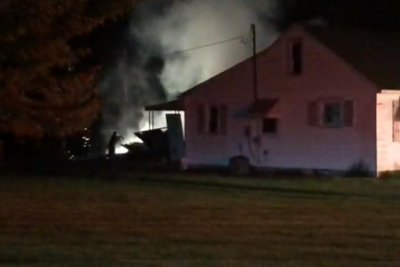 Man using torch to kill weeds sets garage on fire