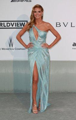 Heidi Klum poses nude for amfAR charity campaign
