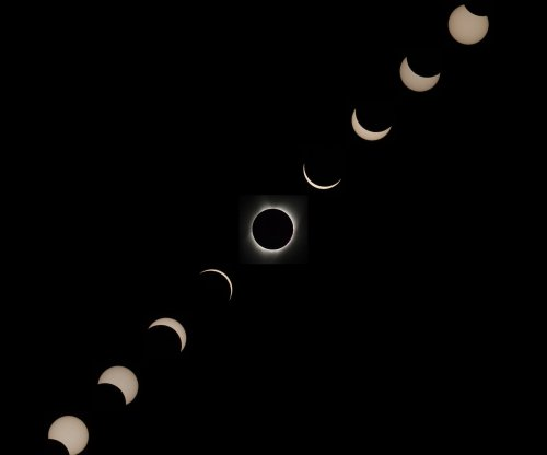 Eclipse nears U.S. West Coast as millions prepare for historic event