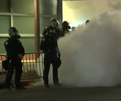 Police use tear gas, flash grenades to control crowd after Trump rally in Phoenix