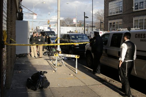 Pawn shop owner arrested on weapons charges after connection to Jersey City shooters