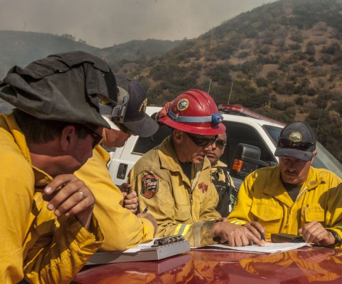 Thousands evacuated as firefighters lose ground on California wildfire