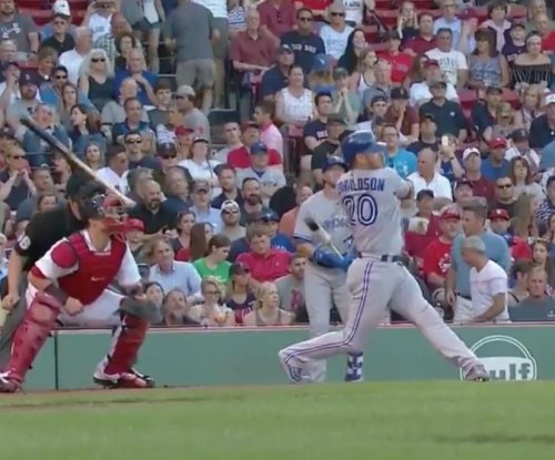 Toronto Blue Jays' Josh Donaldson hits umpire with bat on backswing