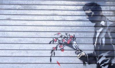 Hustler Club says it's honored to have Banksy art on security gate