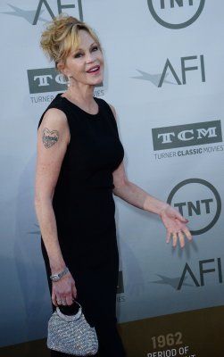 Melanie Griffith covers up 'Antonio' tattoo after divorce filing