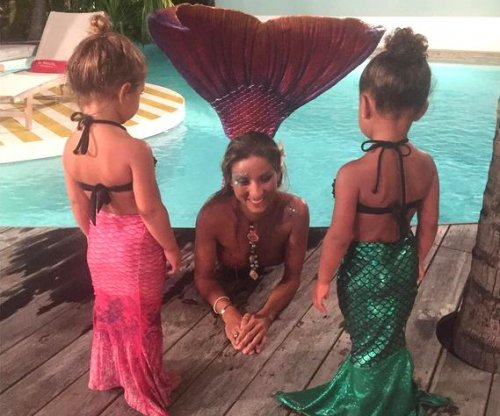North West, cousin Penelope Disick meet a mermaid during Caribbean vacation