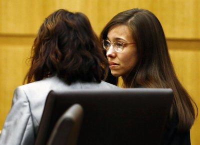 Arias sends upbeat tweet as prosecutors mull new sentencing trial
