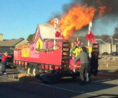 Grinch-themed parade float goes up in flames thanks to real-life Grinch's cigarette butt