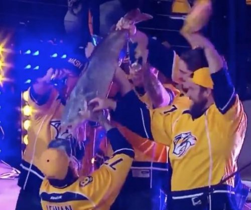 Titans lineman chugs beer out of dead catfish during Preds game