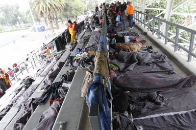 Mexico City welcomes migrant caravan with shelter, aid
