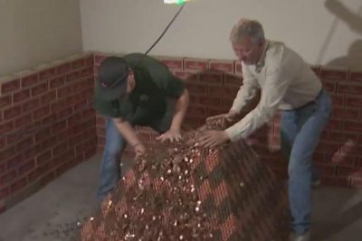 Man cashes in record-breaking penny pyramid for $10,303.15