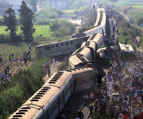 Trains collide head-on in Egypt, dozens dead