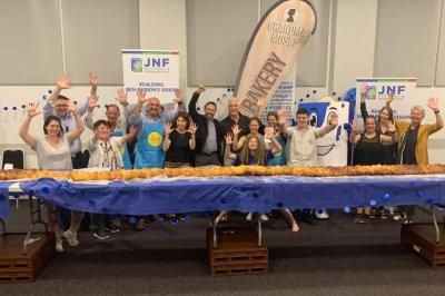 Kosher bakery creates 32-foot-long challah for Guinness record