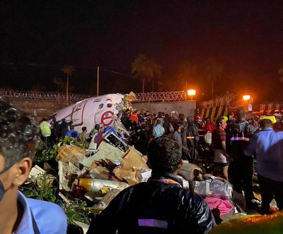 Air India flight crashes landing in the rain; at least 2 dead