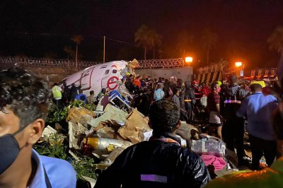 Air India flight crashes landing in the rain; at least 20 dead