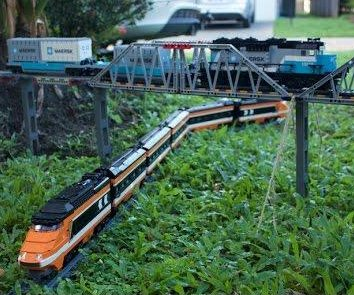 Man spends two weeks creating Lego train track around his home and yard