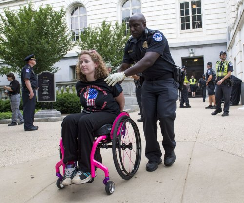 Disabled protesters stage sit-in outside Sen. Mitch McConnell's office