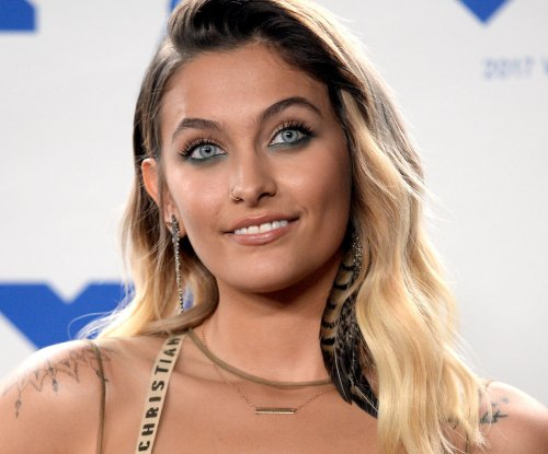 Paris Jackson shows off new chakra tattoos down her sternum