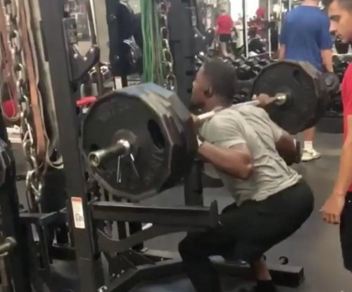 Cardinals' David Johnson does three 495-pound squat reps
