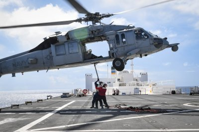 Navy begins deep-sea search for downed helicopter, remains of crew